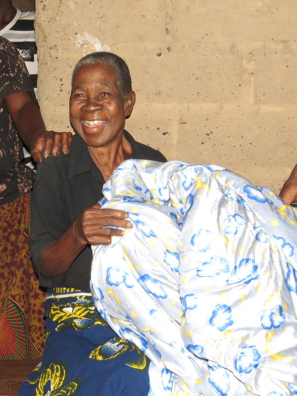 A Christian Aid Comforter Brings a Smile